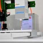 Automated dispensing and UV light curing system